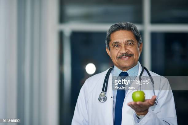 i recommend at least one of these a day - nutritionist stock pictures, royalty-free photos & images
