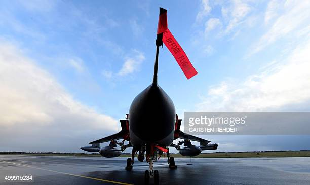 TOPSHOT A reconnaissance jet Tornado of the German Air Force Luftwaffe is presented at the military airfeld in Jagel northern Germany on December 4...
