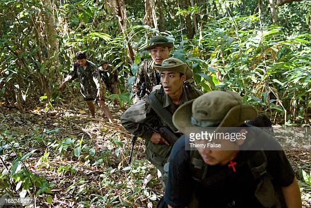 A reconnaissance team made of Karen guerillas and Free Burma Rangers members approaches a hill facing Maw Pu a main Burma army camp in Northern Karen...