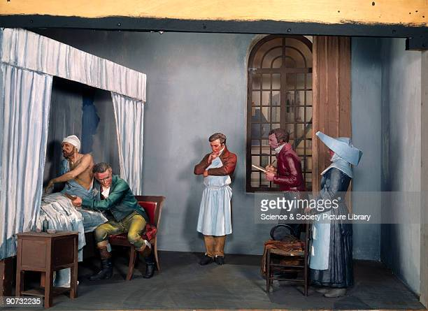 Reconstruction in the Lower Wellcome Gallery Science Museum London showing French physician Rene Theophile Hyacinthe Laennec examining a patient with...