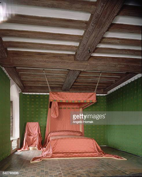Reconstruction of a medieval bed stands within a beamed room at Leeds castle, in Kent.