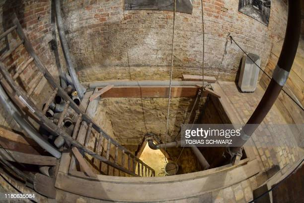 A reconstruction of a tunnel formerly used to escape former East Germany at Bernauer Strasse is pictured in Berlin on November 7 2019 during the...