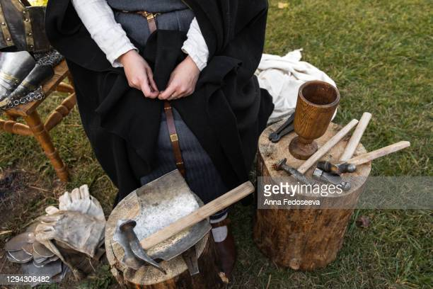 reconstruction of ancient crafts. a merchant at the fair sells armor. metal tools, hammers. - rpg maker stock pictures, royalty-free photos & images