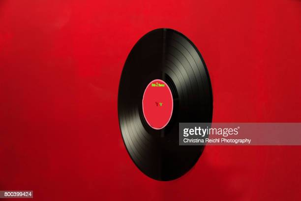 Record against red background