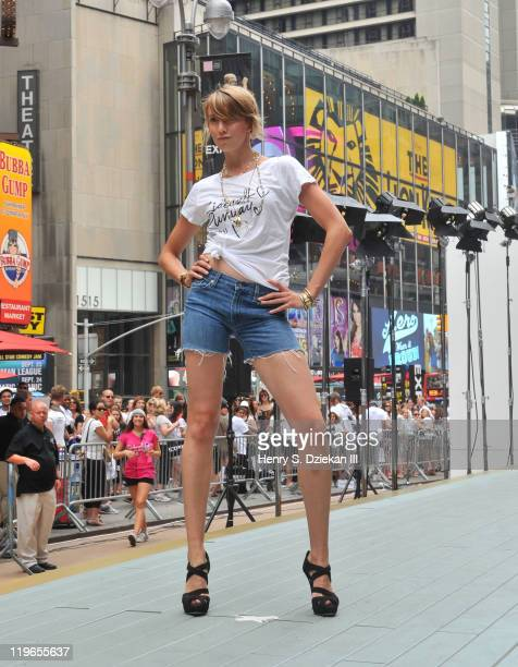 Record breaking participant Lauren Griffin walks the runway as Express breaks Guinness World Record in Times Square on July 23 2011 in New York City