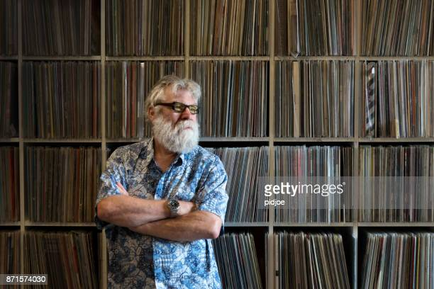 record collector in front of his collection, looking away. - collection stock pictures, royalty-free photos & images