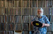 Record collector in front of his collection