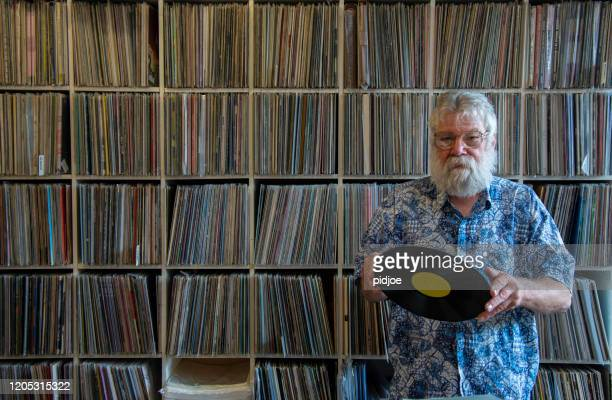 record collector in front of his collection - collection stock pictures, royalty-free photos & images