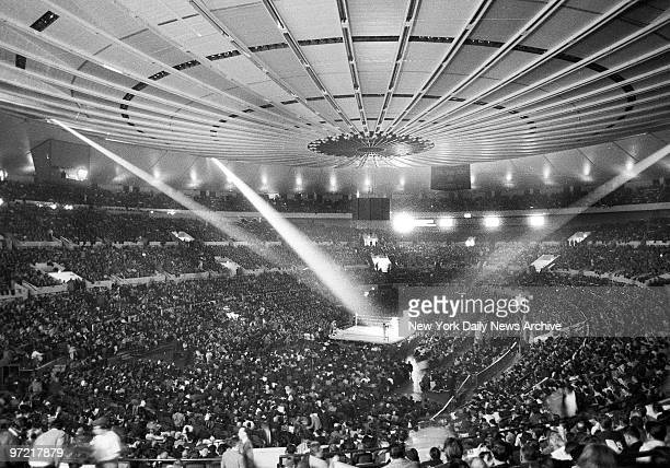 Record crowd of 19,959 jams Madison Square Garden for the Finals of the Golden Gloves. In the spotlight are two of the hopefuls clashing for crowns...
