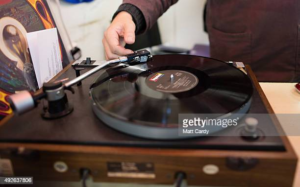 A record dealer in Wanted Records in St Nicholas Market puts on a vinyl record on the shop's turntable on October 14 2015 in Bristol England Although...