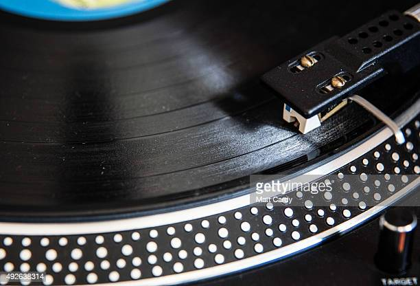 Record dealer in Wanted Records in St Nicholas Market puts on a vinyl record on the shop's turntable on October 14, 2015 in Bristol, England....