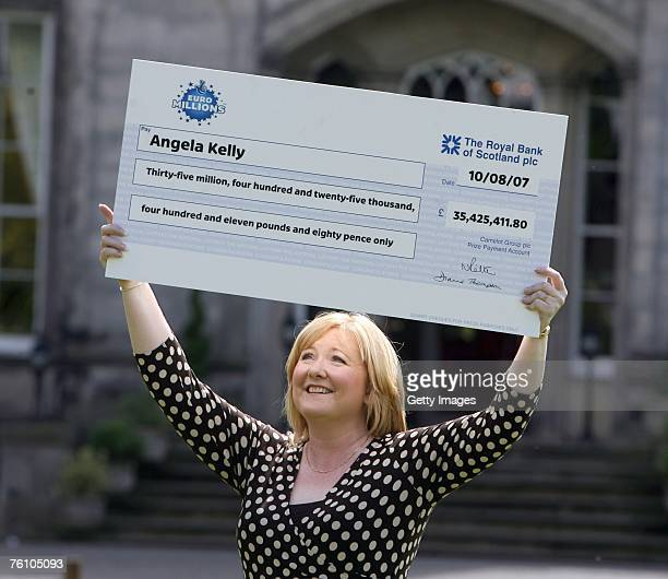 Record Euro Lottery winner Angela Kelly celebrates her win in front of assembled media August 15 2007 in Falkirk Scotland Kelly who scooped a 354...