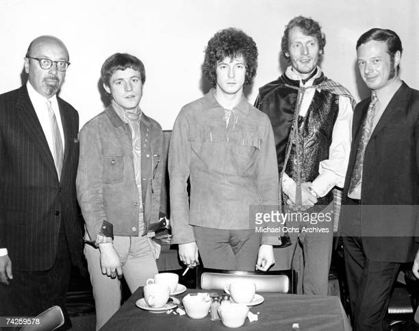 Record executive Ahmet Ertegun, bassist Jack Bruce, guitarist Eric Clapton, drummer Ginger Baker and manager Brian Epstein pose for a portrait in...