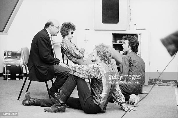 Record executive Ahmet Ertegun rock and roll guitarist Eric Clapton of the rock band Cream drummer Ginger Baker and record producer Felix Pappalardi...
