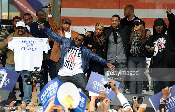 Record executive Kevin Liles rapper Sean Diddy Combs singer Mary J Blige and rapper JayZ are seen at a Promote The Vote Block Party in support of...