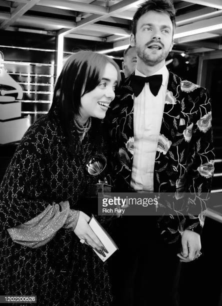 Record of the Year award winner Billie Eilish and Finneas O'Connell celebrate during the 62nd Annual GRAMMY Awards at STAPLES Center on January 26...