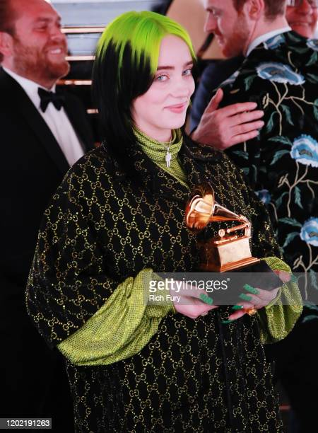 Record of the Year award winner Billie Eilish celebrates during the 62nd Annual GRAMMY Awards at STAPLES Center on January 26 2020 in Los Angeles...