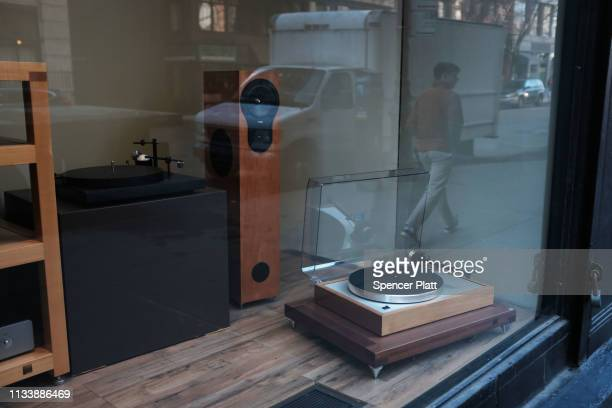A record player is displayed in the window of a store on March 05 2019 in New York City A new report by the Recording Industry Association of America...