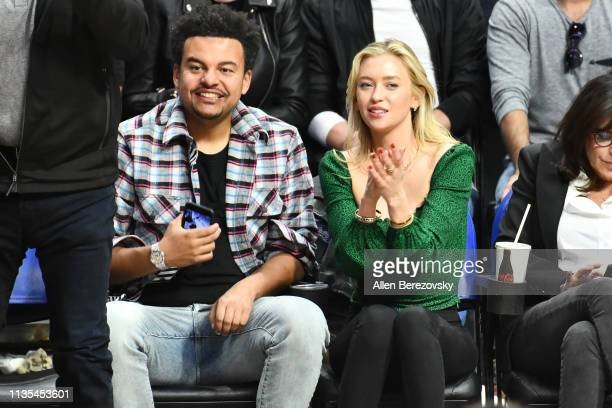 Record producer Alex da Kid and a guest attend a basketball game between the Los Angeles Clippers and Portland Trail Blazers at Staples Center on...