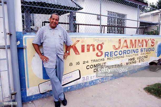 Record producer and dub mixer King Jammy poses outside his recording studio in Kingston Jamaica October 1998