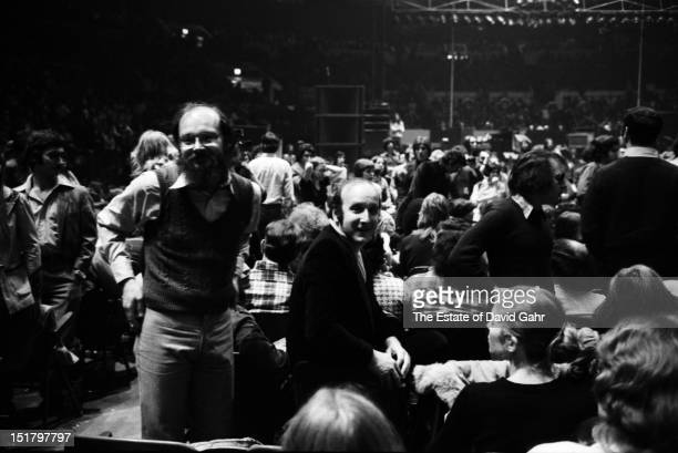 Record producer and music industry executive Clive Davis and Paul Simon attend a performance by Bob Dylan and The Band at Madison Square Garden in...