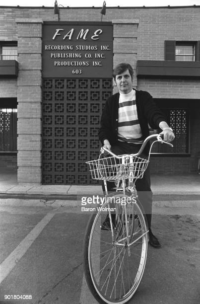 Record producer and recording studio owner Rick Hall poses on a bicycle outside his FAME Studios in Muscle Shoals Alabama March 1969