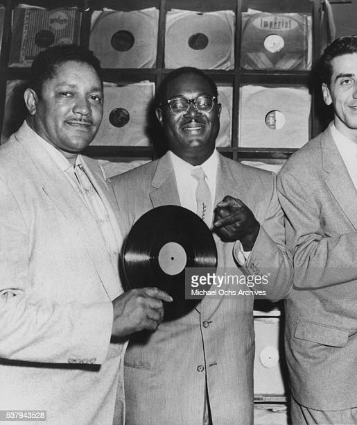 Record producer and records store owner John Dolphin RB saxophonist Earl Bostic and DJ Dick 'Huggy Boy' Hugg at 'Dolphin's of Hollywood' in Los...