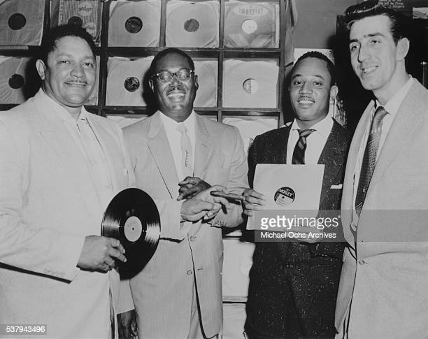 Record producer and records store owner John Dolphin RB saxophonists Earl Bostic and Joe Houston with DJ Dick 'Huggy Boy' Hugg at 'Dolphin's of...