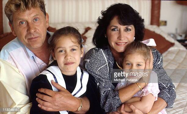 Record producer and songwriter Mickie Most at home with his wife Christina and children Nathalie and Cristalle in Totteridge London circa 1988