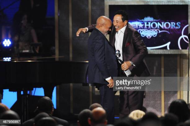 Record producer Berry Gordy and musician Smokey Robinson appear onstage at BET Honors 2014 at Warner Theatre on February 8 2014 in Washington DC