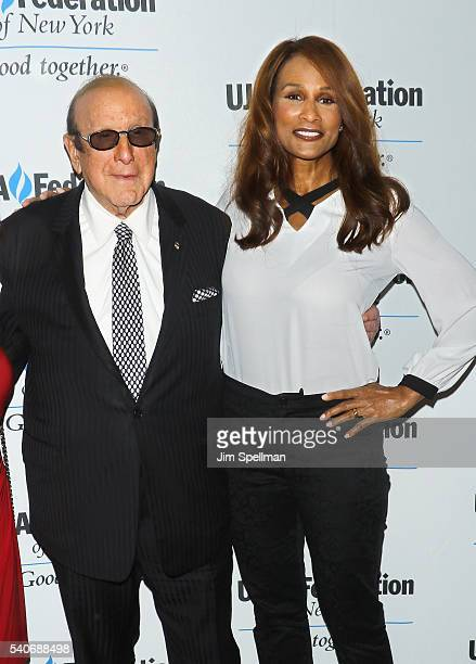 Record producer Clive Davis and model Beverly Johnson attend the 2016 UJAFederation of New York's Music Visionary of the Year Award luncheon at The...