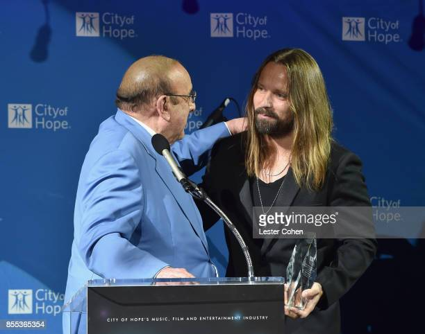 "Record producer Clive Davis presents Honoree Max Martin with the ""Clive Davis Legend in Songwriting"" Award at City of Hope's Music Film and..."
