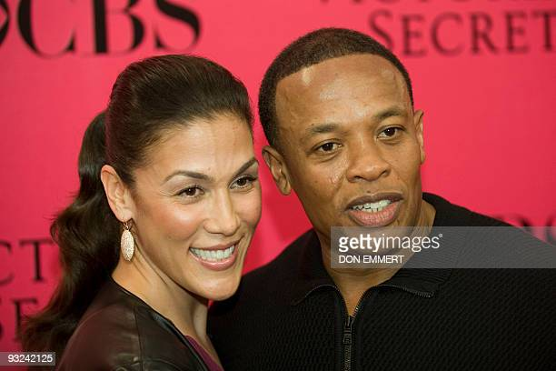 Record producer Dr Dre and his wife Nicole arrive at the 2009 Victoria's Secret fashion show November 19 2009 in New York AFP PHOTO / DON EMMERT