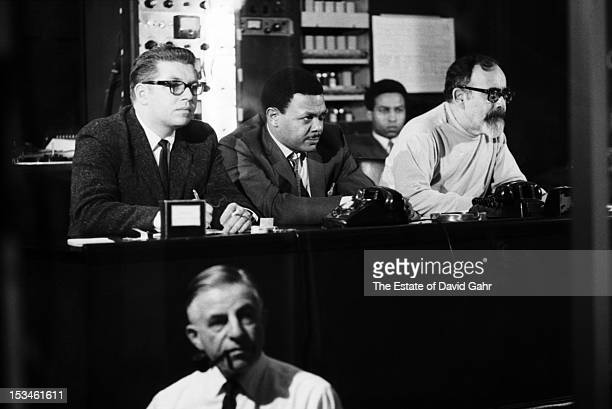 Record producer Jerry Wexler and Ted White in the engineer's booth at a recording session for soul singer Aretha Franklin at Atlantic Records studios...