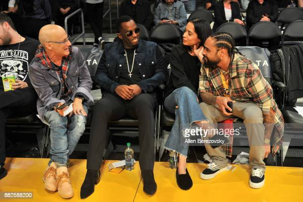 Record producer Jimmy Iovine Sean 'Diddy' Combs and Jerry Lorenzo attend a basketball game between the Los Angeles Lakers and the Golden State...
