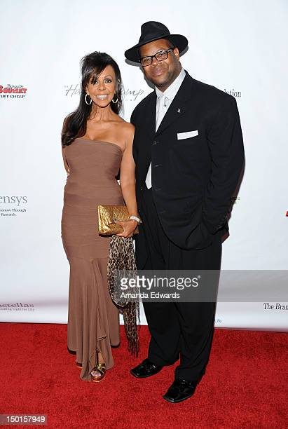 Record producer Jimmy Jam and his wife Lisa Padilla arrive at the 12th Annual Harold Pump Foundation Gala on August 10, 2012 in Los Angeles,...