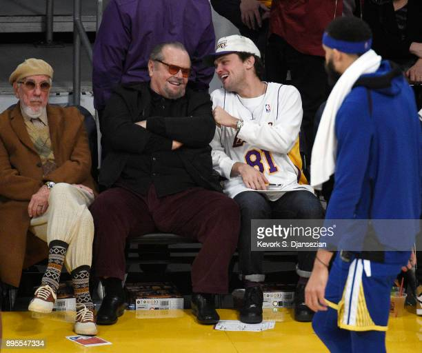 Record producer Lou Adler actor Jack Nicholson and Ray Nicholson attend a basketball game between the Golden State Warriors and Los Angeles Lakers...