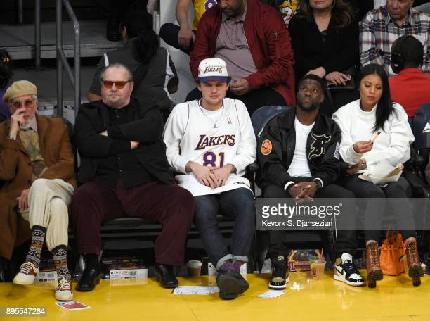 Record producer Lou Adler actor Jack Nicholson Ray Nicholson actor Kevin Hart and his wife Eniko Parrish attend a basketball game between the Golden...