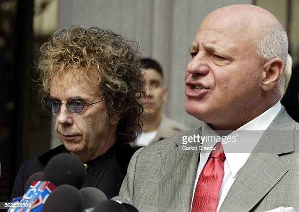 Record producer Phil Spector listened as attorney Bruce Cutler talked to the media on the grounds of the Criminal Courts Building in Los Angeles...