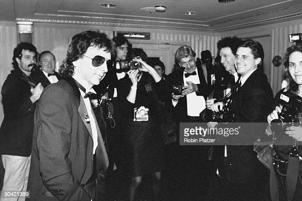 Record producer Phil Spector surrounded by news photographers as he arrives at the Rock & Roll Hall of Fame induction banquet at the Waldorf-Astoria...