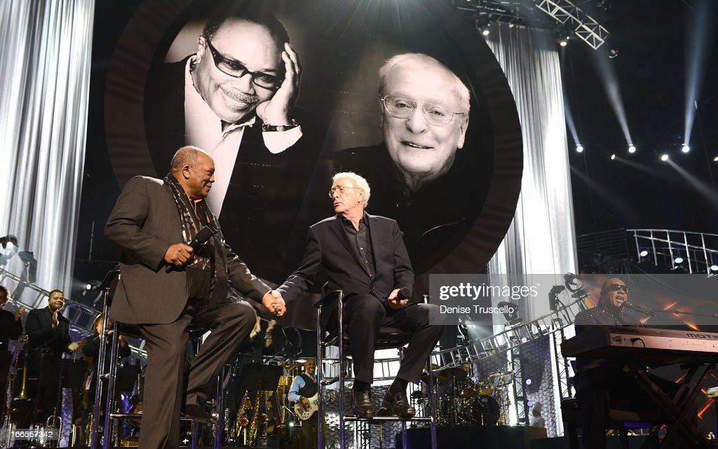 Record producer Quincy Jones (L) and actor Sir Michael Caine greet each other as recording artist Stevie Wonder (R) performs onstage during the 17th annual Keep Memory Alive 'Power of Love Gala' benefit for the Cleveland Clinic Lou Ruvo Center for Brain Health celebrating the 80th birthdays of Quincy Jones and Sir Michael Caine on April 13, 2013 in Las Vegas, Nevada.