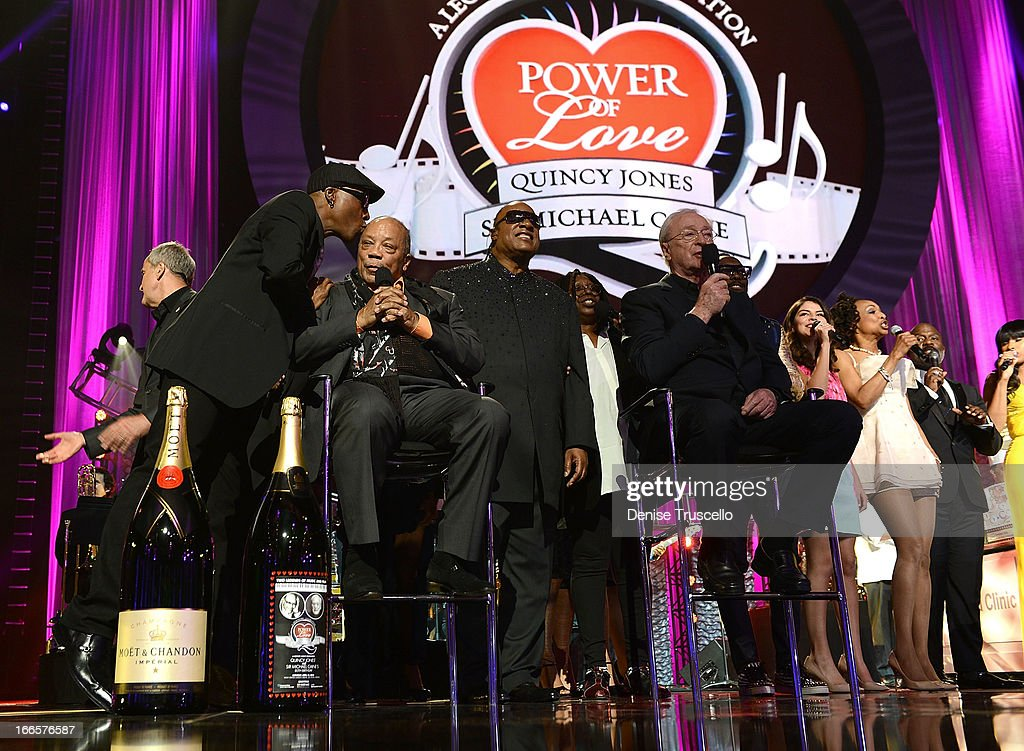 Record producer Quincy Jones, recording artist Stevie Wonder, actress Whoopi Goldberg, actor Sir Michael Caine and recording artist will.I.am onstage during the 17th annual Keep Memory Alive 'Power of Love Gala' benefit for the Cleveland Clinic Lou Ruvo Center for Brain Health celebrating the 80th birthdays of Quincy Jones and Sir Michael Caine on April 13, 2013 in Las Vegas, Nevada.