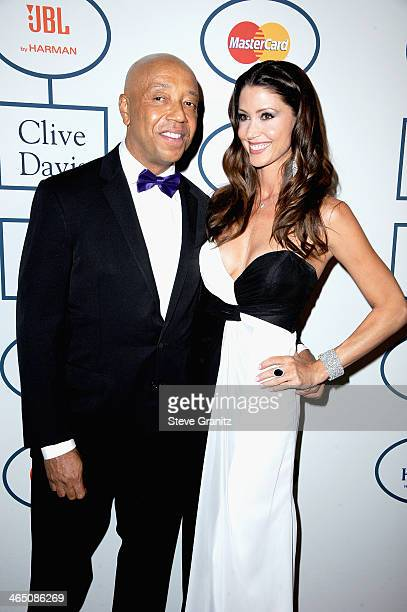 Record producer Russell Simmons and actress Shannon Elizabeth attend the 56th annual GRAMMY Awards PreGRAMMY Gala and Salute to Industry Icons...