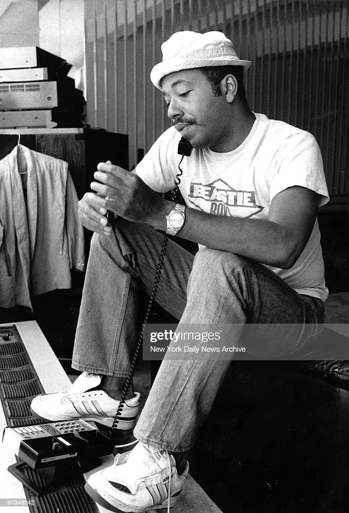 Record producer Russell Simmons on the phone at 111 Barrow S