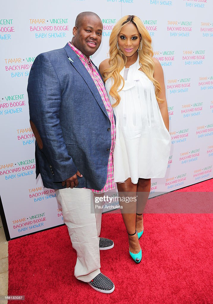Record Producer Vincent Herbert (L) and his wife Reality TV Personality Tamar Braxton attend their carnival themed baby shower at the Hotel Bel-Air on May 5, 2013 in Los Angeles, California.