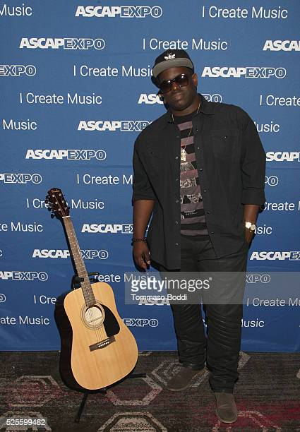 Record producer Warryn Campbell poses with a #StandWithSongwriters guitar which will be presented in May to members of Congress to urge them to...