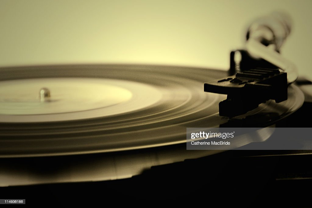 Record spinning on record player : Stock Photo