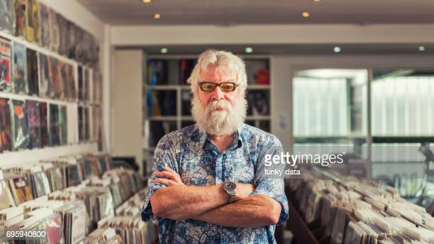record store owner portrait - dutch culture stock photos and pictures