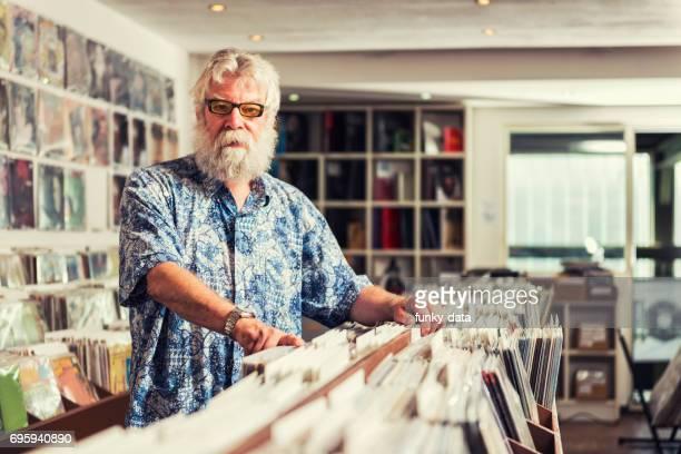 Record store owner senior man
