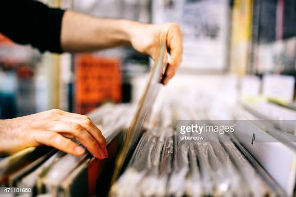 Record store, second hand vinyl records, hands searching